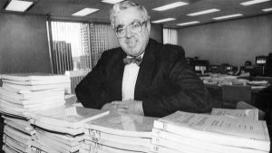 In Edmonton in December, 1988, William Code leans on a stack of nearly 40,000 pages of testimony from 205 days of hearings collected as part of the Code Inquiry, which he conducted from from 1987 to 1989. (Ray Giguere For The Globe and Mail)